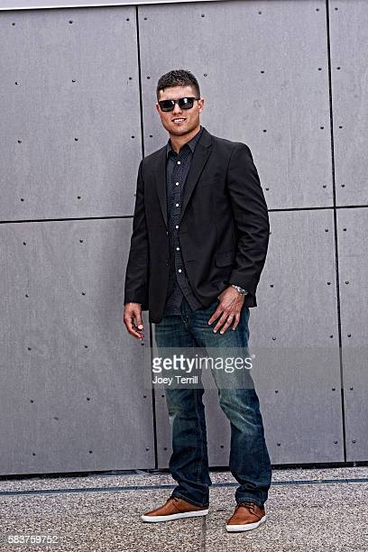 National League AllStar Aledmys Diaz of the St Louis Cardinals poses for a portrait as he enters Petco Park following the Red Carpet parade before...