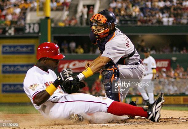 National League AllStar Alfonso Soriano of the Washington Nationals gets tagged out at home American League AllStar Ivan Rodriguez of Detroit Tigers...