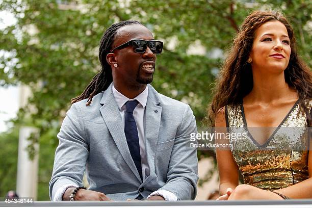 National League AllStar Andrew McCutchen of the Pittsburgh Pirates rides with his fiancee Maria Hanslovan in the Red Carpet Parade leading to the...
