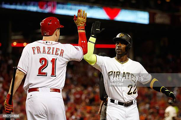 National League AllStar Andrew McCutchen of the Pittsburgh Pirates celebrates with National League AllStar Todd Frazier of the Cincinnati Reds after...
