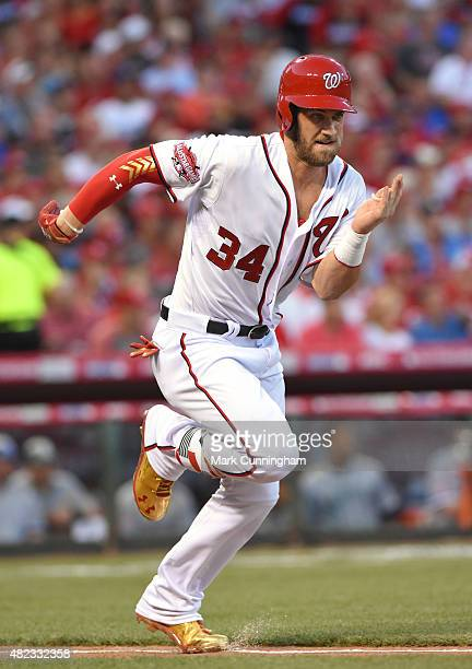 National League AllStar Bryce Harper of the Washington Nationals runs to first base during the 86th MLB AllStar Game at Great American Ball Park on...