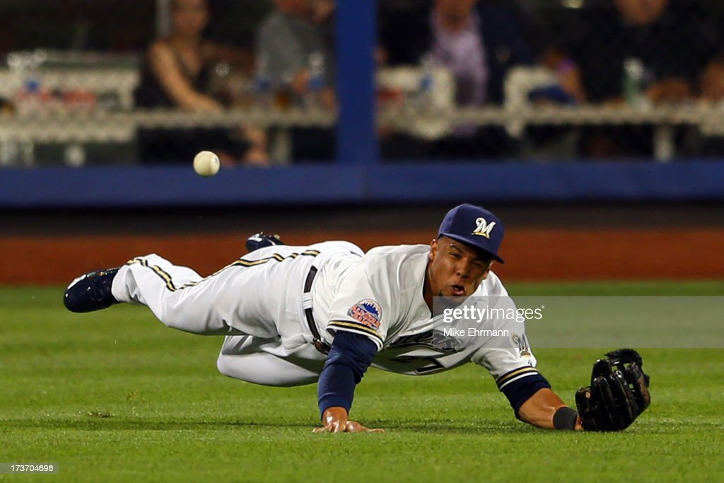 National League All-Star Carlos Gonzalez #5 of the Colorado Rockies fails to make a play on a ball hit by American League All-Star Prince Fielder #28 of the Detroit Tigers in the ninth inning during the 84th MLB All-Star Game on July 16, 2013 at Citi Field in the Flushing neighborhood of the Queens borough of New York City.