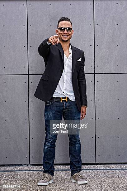 National League AllStar Carlos Gonzalez of the Colorado Rockies poses for a portrait as he enters Petco Park following the Red Carpet parade before...