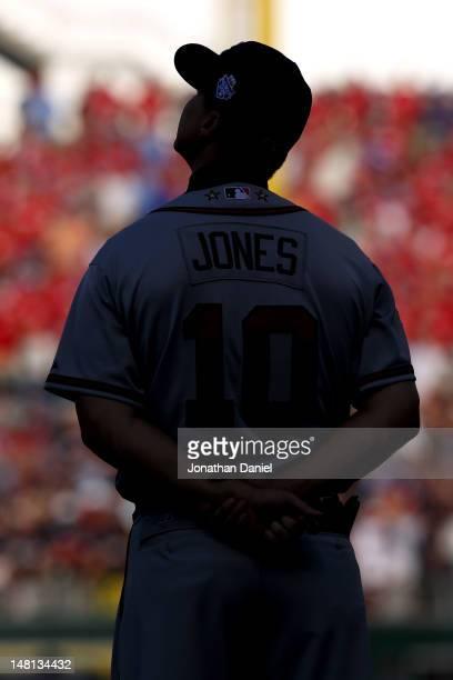 National League AllStar Chipper Jones of the Atlanta Braves looks on during pregame festivities for the 83rd MLB AllStar Game at Kauffman Stadium on...