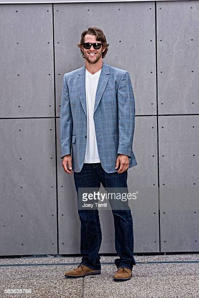 National League AllStar Clayton Kershaw of the Los Angeles Dodgers poses for a portrait as he enters Petco Park following the Red Carpet parade...