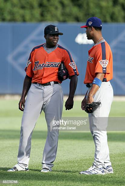 National League AllStar Dontrelle Willis of the Florida Marlins and Derrek Lee of the Chicago Cubs talk on the field during batting practice for the...