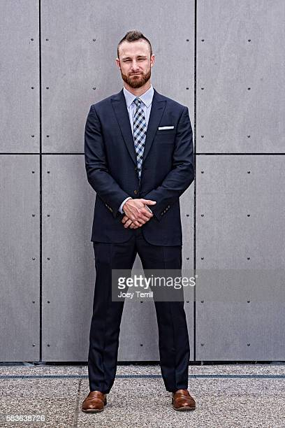National League AllStar Jonathan Lucroy of the Milwaukee Brewers poses for a portrait as he enters Petco Park following the Red Carpet parade before...