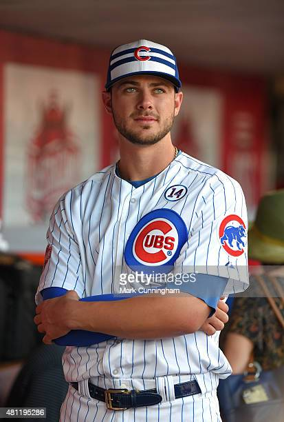 National League AllStar Kris Bryant of the Chicago Cubs looks on from the dugout prior to the 86th MLB AllStar Game at Great American Ball Park on...