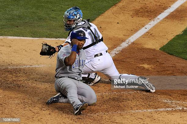 National League AllStar Marlon Byrd of the Chicago Cubs slides in safe at home plate to score the third run for the National League in the seventh...