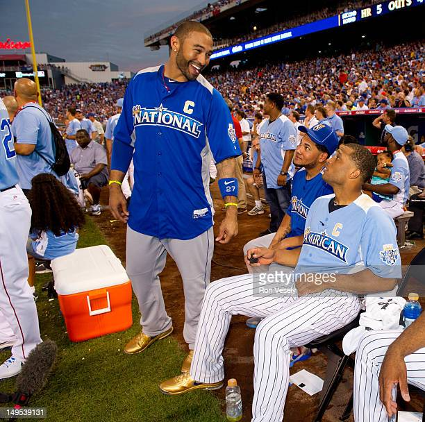 National League AllStar Matt Kemp of the Los Angeles Dodgers jokes with National League AllStar Melky Cabrera of the San Francisco Giants and...