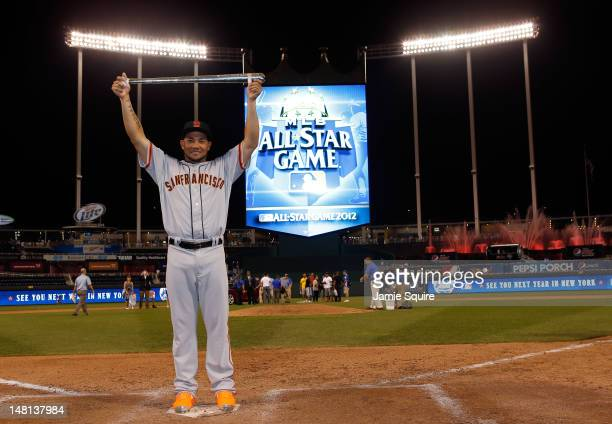 National League AllStar Melky Cabrera of the San Francisco Giants holds up the Ted Williams Most Valuable Player Award after the National League won...
