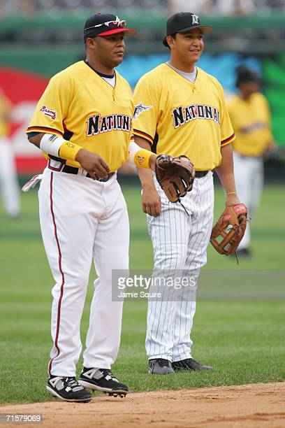 National League AllStar outfielder Andruw Jones of the Atlanta Braves stands with third baseman Miguel Cabrera of the Florida Marlins during practice...