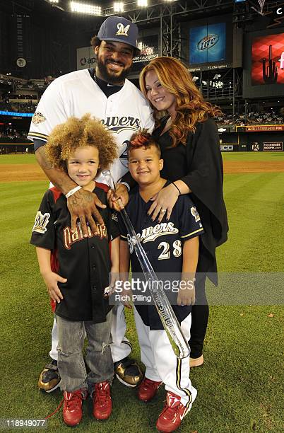 National League AllStar Prince Fielder of the Milwaukee Brewers poses with his wife Chanel and sons Jadyn and Haven after being crowned MVP of the...