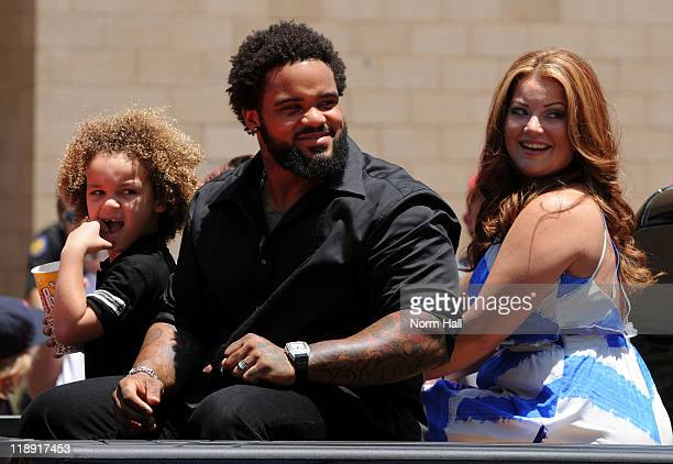 National League AllStar Prince Fielder of the Milwaukee Brewers with son Jaden and wife Chanel ride on a truck down the parade route during the MLB...