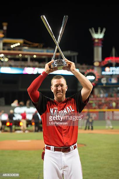 National League AllStar Todd Frazier of the Cincinnati Reds poses with the home derby championship trophy after the Gillette Home Run Derby presented...