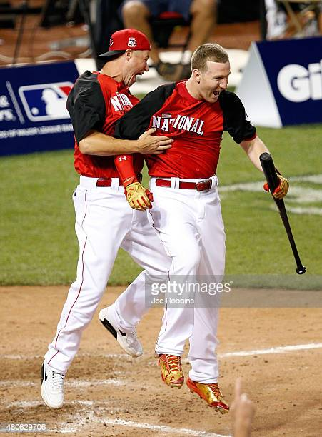 National League AllStar Todd Frazier of the Cincinnati Reds celebrates with his brother Charlie after winning the Gillette Home Run Derby presented...