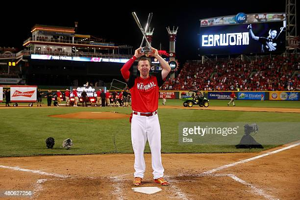 National League AllStar Todd Frazier of the Cincinnati Reds celebrates with the trophy after winning the Gillette Home Run Derby presented by Head...