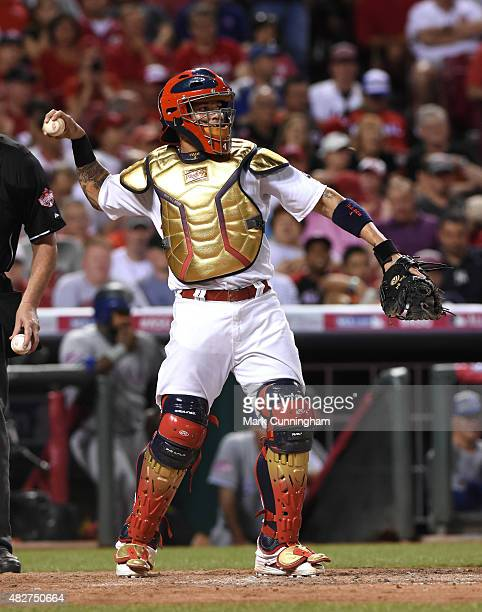 National League AllStar Yadier Molina of the St Louis Cardinals throws a baseball during the 86th MLB AllStar Game at Great American Ball Park on...