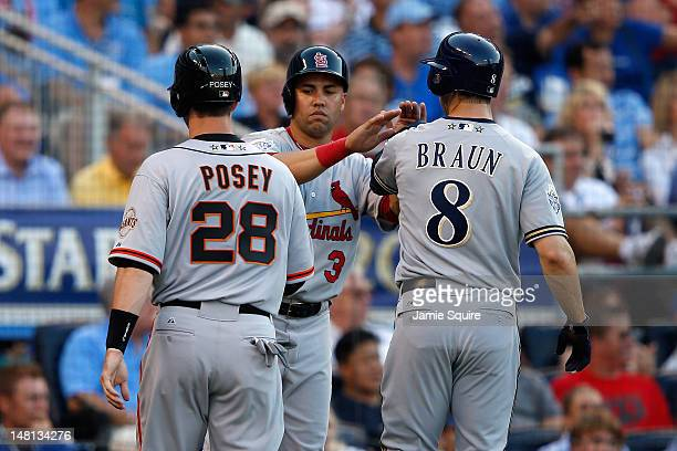 National League All-Stars Buster Posey of the San Francisco Giants, Carlos Beltran of the St. Louis Cardinals and Ryan Braun of the Milwaukee Brewers...