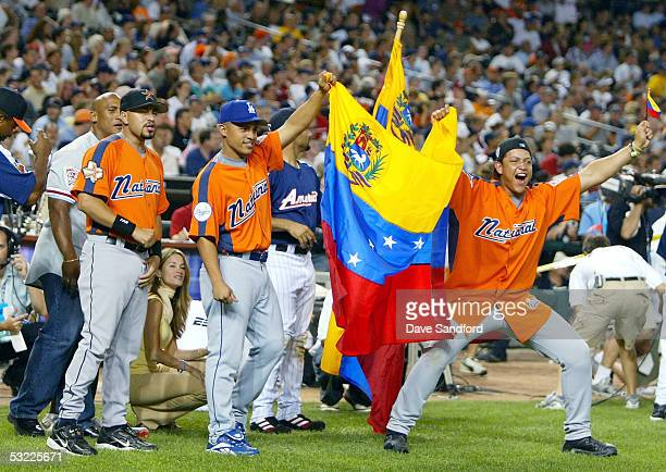 National League AllStars Cesar Izturis of the Los Angeles Dodgers and Miguel Cabrera of the Florida Marlins celebrate as fellow Venezuelan Bobby...