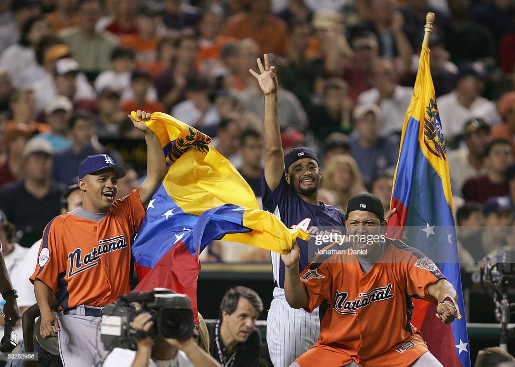 National League All-Stars Cesar Izturis #3 of the Los Angeles Dodgers and Miguel Cabrera #24 of the Florida Marlins celebrate as fellow Venezuelan Bobby Abreu #53 hits a home run during the 2005 Major League Baseball Home Run Derby at Comerica Park on July 11, 2005 in Detroit, Michigan.
