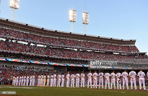 National League AllStars stand together on the field during the National Anthem prior to the 86th MLB AllStar Game at Great American Ball Park on...