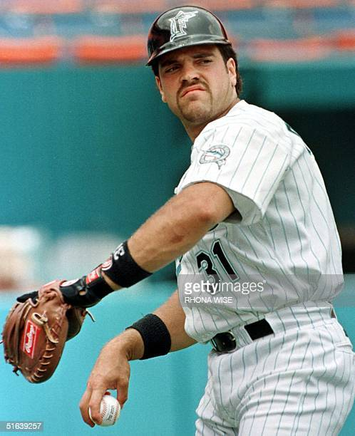National League catcher Mike Piazza shown warming up before a Florida Marlin game 21 May was traded from the Florida Marlins to the New York Mets...
