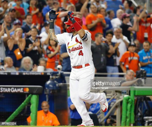 National League catcher Yadier Molina of the St Louis Cardinals salutes the crowd after his home run in the bottom of the sixth inning to tie the...