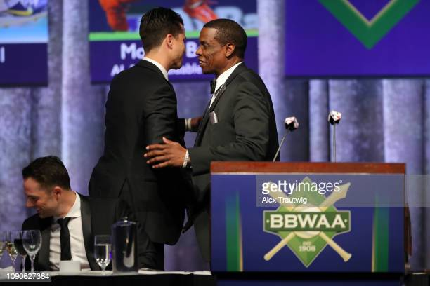 National League Cy Young Award winner Jacob deGrom of the New York Mets shakes hands with Dwight Gooden during the 2019 Baseball Writers' Association...