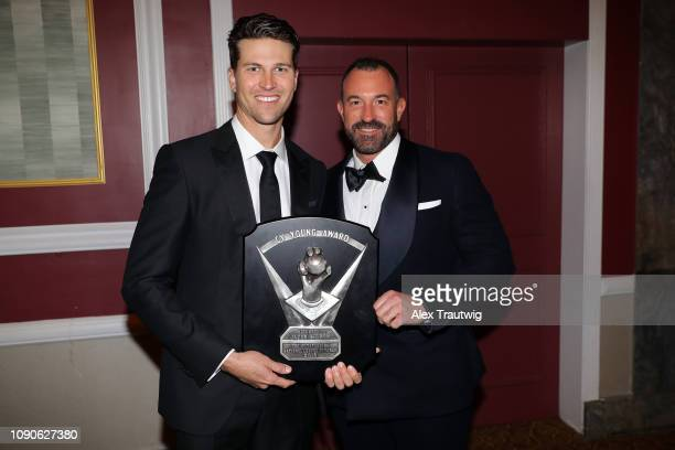 National League Cy Young Award winner Jacob deGrom of the New York Mets poses for a photo with manager Mickey Callaway during the 2019 Baseball...