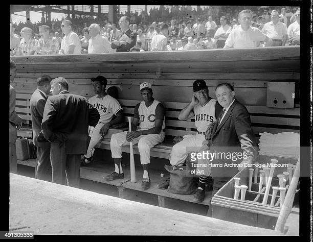 National League dugout with San Francisco Giants Cincinnati Reds and Pittsburgh Pirates baseball players at Forbes Field during 1959 All Star game...