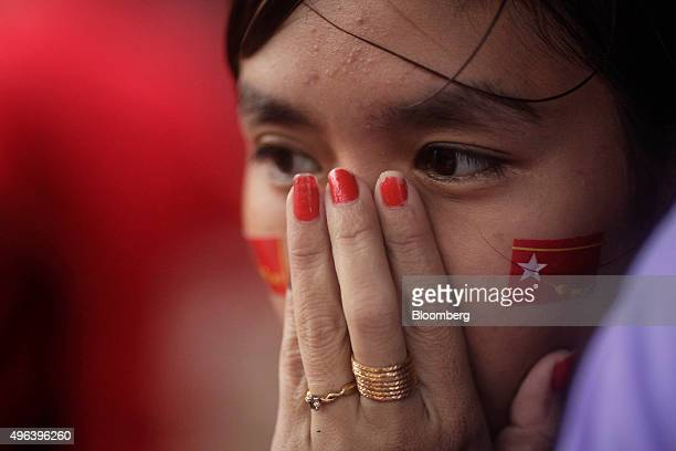 A National League for Democracy party supporter reacts to election results outside the party headquarters in Yangon Myanmar on Monday Nov 9 2015 The...