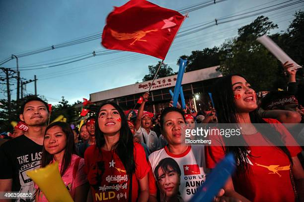 National League for Democracy party supporters celebrate election results outside the party headquarters in Yangon Myanmar on Monday Nov 9 2015 The...
