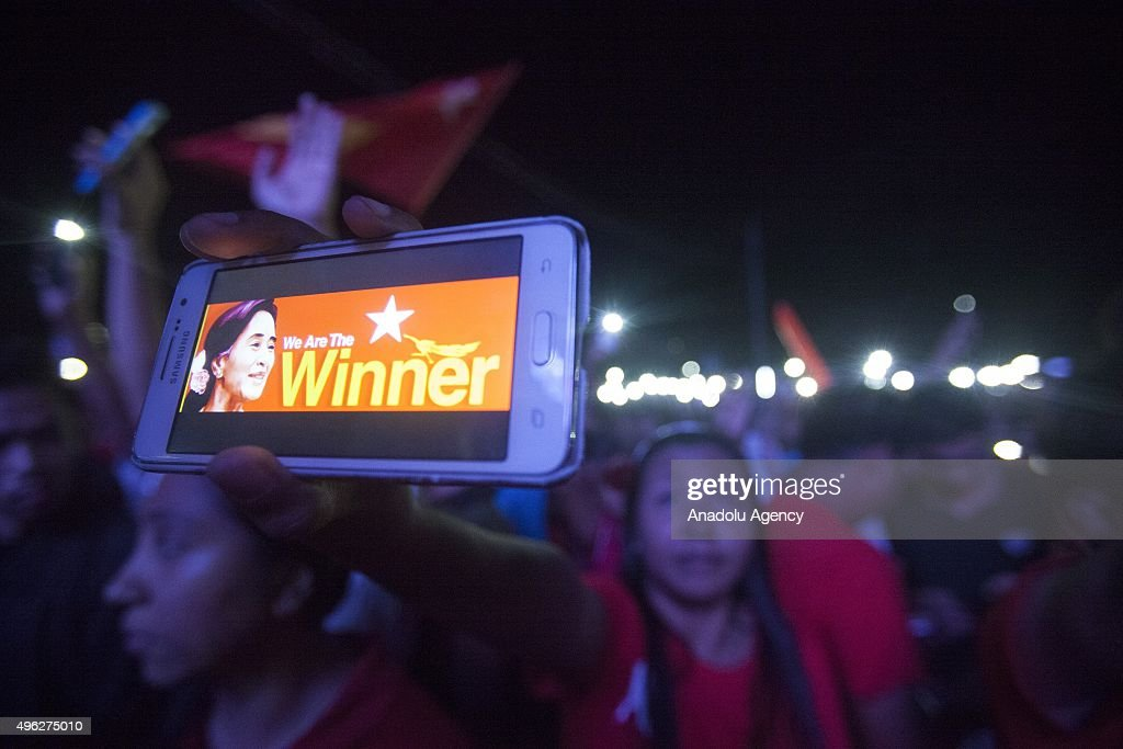 National League for Democracy supporters hold a rally in front of the NLD headquarters in Yangon at the end of the voting day on November 8, 2015. Myanmar votes in historic elections that could put Aung San Suu Kyi's National Democracy League in power and loosen the military regime that has been governing the country.