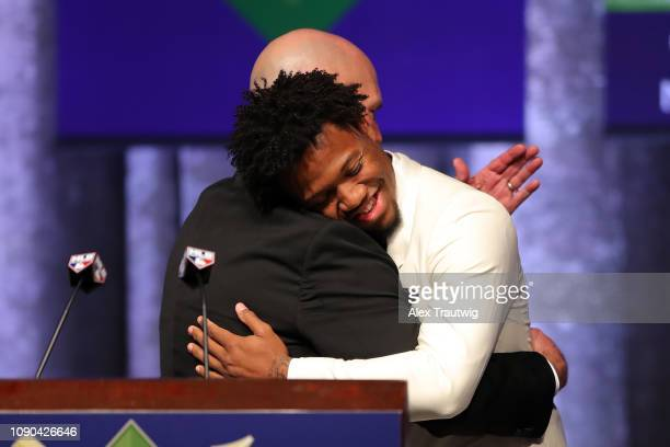 National League Jackie Robinson Rookie of the year Ronald Acuña Jr of the Atlanta Braves hugs manager Brian Snitker during the 2019 Baseball Writers'...