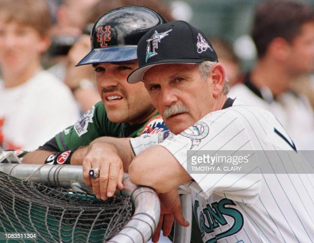 National League Manager Jim Leyland and catcher Mike Piazza watch batting practice prior to the start of the 1998 Major League AllStar game 07 July...