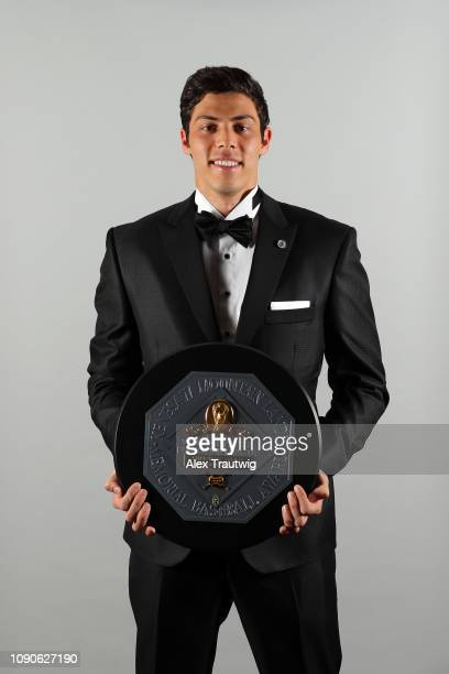 National League MVP Christian Yelich of the Milwaukee Brewers poses for a photo during the 2019 Baseball Writers' Association of America awards...
