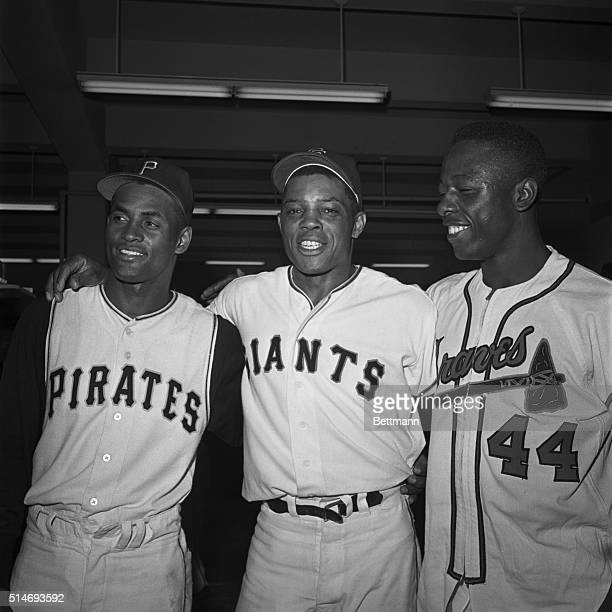 National League stars Roberto Clemente, Willie Mays, and Hank Aaron stand together for a victory portrait after the All-Star Game of 1961 in San...