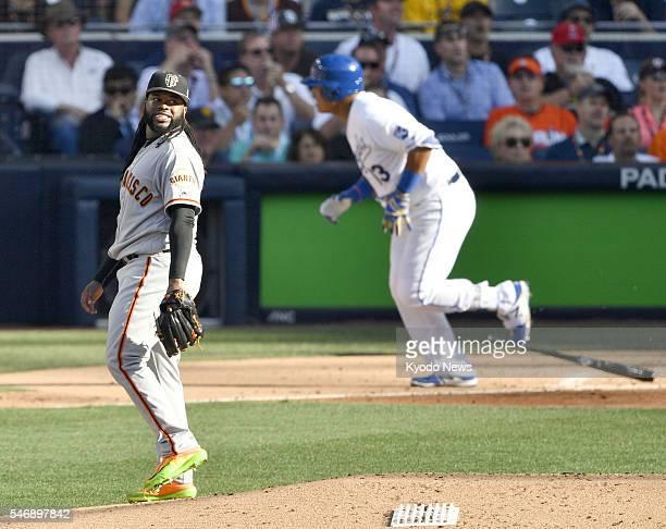 National League starter Johnny Cueto of the San Francisco Giants allows a tworun homer to American League catcher Salvador Perez of the Kansas City...