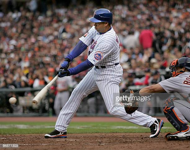 National League's Carlos Beltran of the New York Mets hits a triple during the sixth inning Major League Baseballs's AllStar game in San Francisco on...