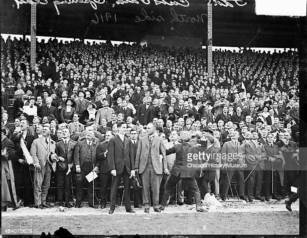 National League's Chicago Cubs baseball game spectators standing in the grandstands on opening day at Weeghman Park Chicago Illinois 1916 Weeghman...