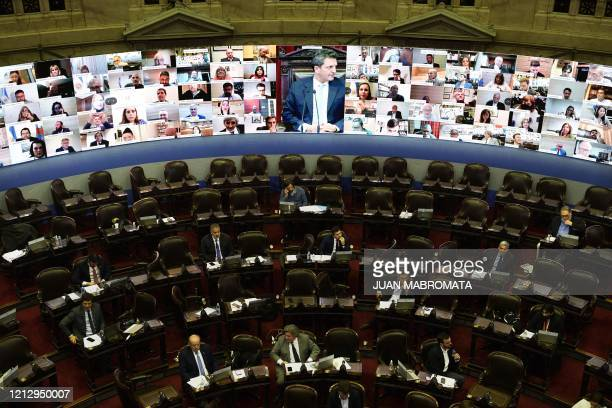 National legislator and President of the Lower Chamber Sergio Massa is seen on the screen during the first virtual session at the Argentine Congress...