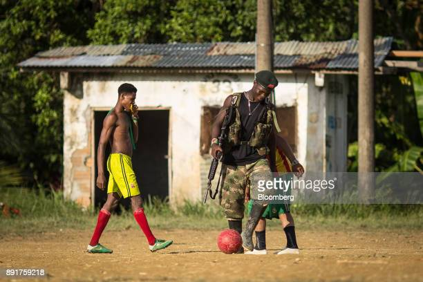 A National Liberation Army guerrilla joins local residents during a game of soccer in a remote village in Choco Department Colombia on Friday Nov 17...