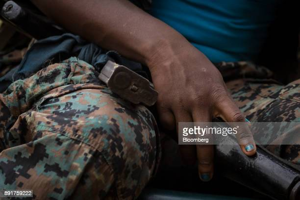 A National Liberation Army guerrilla sits holding her weapon in a remote village in Choco Department Colombia on Friday Nov 17 2017 The Cold War...