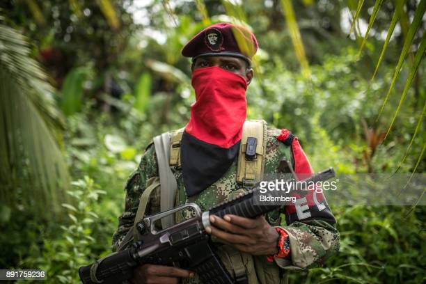 A National Liberation Army guerrilla stands for a photograph in a remote village in Choco Department Colombia on Sunday Nov 19 2017 The Cold War...