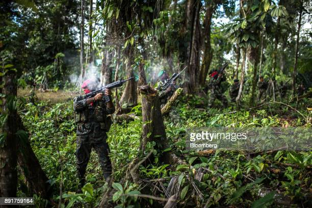 National Liberation Army guerrillas fire weapons during a drill in a remote village in Choco Department Colombia on Saturday Nov 18 2017 The Cold War...