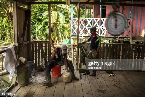 National Liberation Army guerrillas make a homemade mortar known as a pipeta outside in a remote village in Choco Department Colombia on Friday Nov...