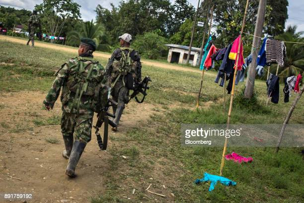 National Liberation Army guerrillas patrol the grounds of a remote village in Choco Department Colombia on Friday Nov 17 2017 The Cold War ended a...