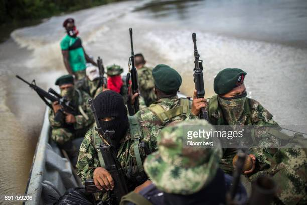National Liberation Army guerrillas patrol the waters of the San Juan River near a remote village in Choco Department Colombia on Friday Nov 17 2017...