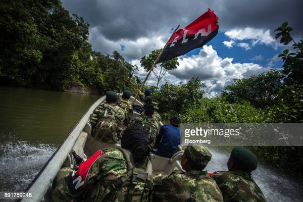 National Liberation Army guerrillas patrol the waters of the San Juan River near a remote village in Choco Department Colombia on Saturday Nov 18...